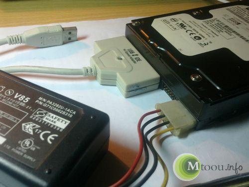 移动硬盘的组成部分:机械硬盘陪IDE转usb+电源适配器